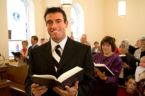 religious guy in suit at a church
